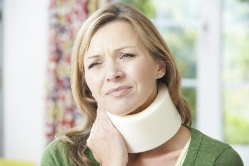 47816619 - woman wearing surgical collar in pain